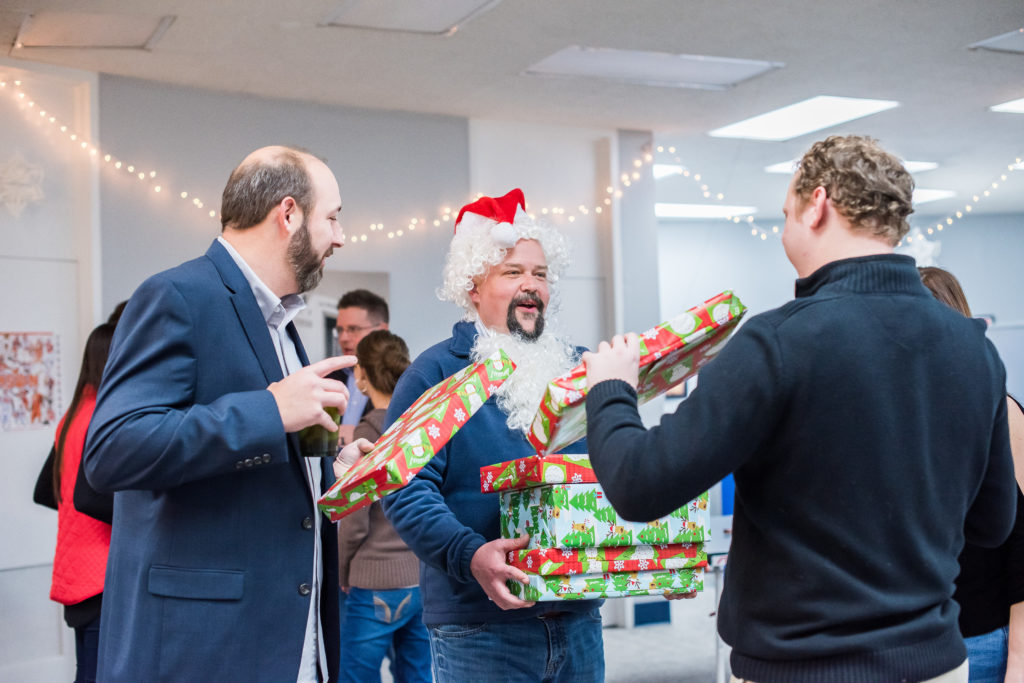 Group of man exchanging gifts